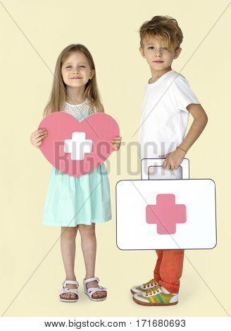 Little Children Holding First Aid Heart Papercraft