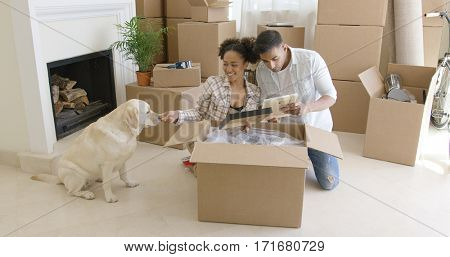 Young woman petting her pet dog