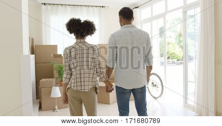 Loving young couple saying goodbye to their home