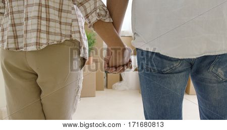 Loving young couple holding hands
