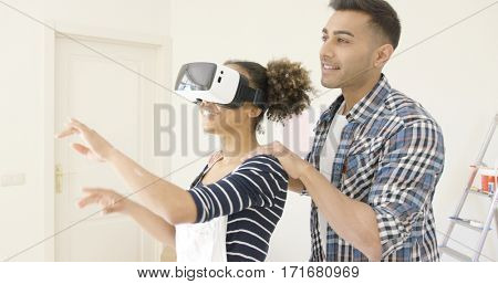 Woman in overalls and virtual reality glasses