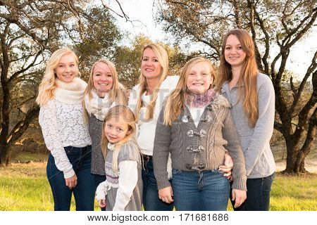 Beautiful Family of Girls Standing in Green Grassy Field