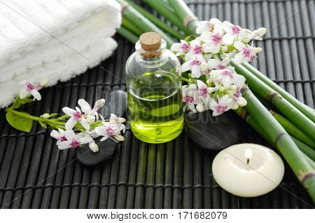 Tropical spa on bamboo mat with grove, towel,candle,