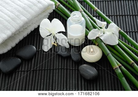 Tropical spa on bamboo mat with grove, towel,oil