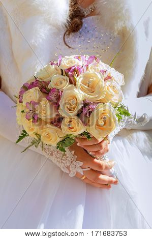 Bride In A Designer Dress Holding A Rose Bouquet.