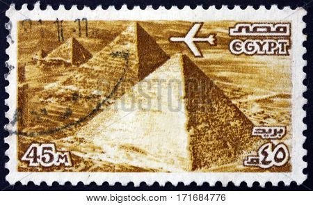 EGYPT - CIRCA 1978: a stamp printed in Egypt shows Airplane over Giza pyramids circa 1978
