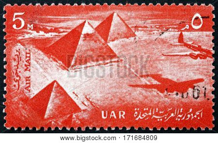EGYPT - CIRCA 1959: a stamp printed in Egypt shows Airplane over Giza pyramids circa 1959