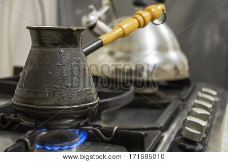 Preparation of coffee on a plate on naked flame