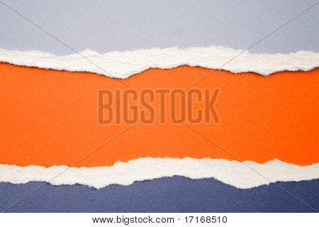 Ripped  paper on orange background