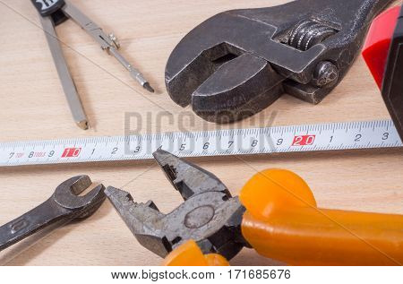 wrench on a wooden background tool for loosening nuts and bolts