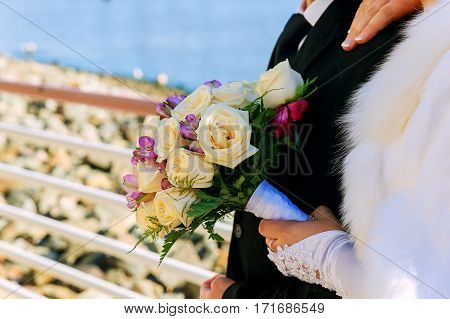 bride and groom on wedding day bride holding wedding bouquet