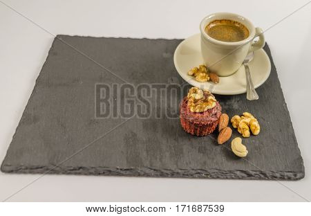 The little black coffee with nut muffin walnuts almonds and cashew nuts whole black stone plate sweet energetic set