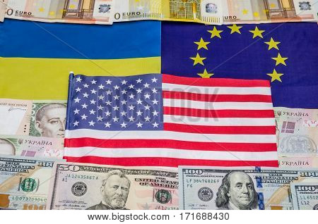 flags of America of Europe and Ukraine with money