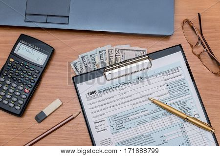 tax form with computer on table close up