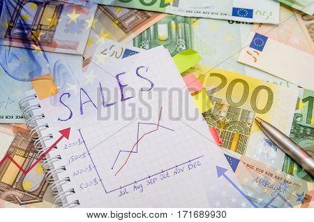 Finance system concept - graph, money close up