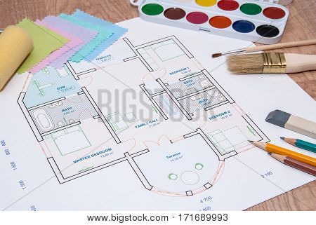 architectural plan of the house with color palette pencil and fabric samples