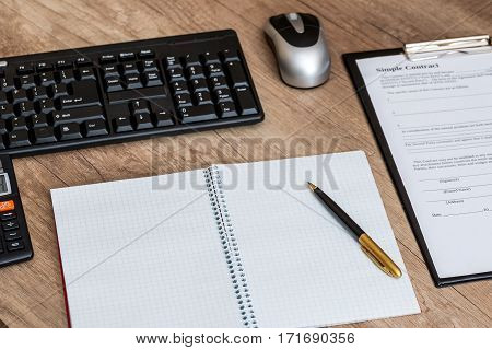 blank paper pen keyboard and blank contract