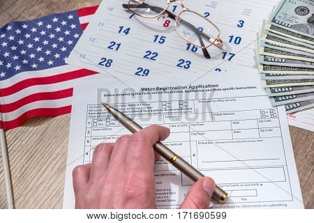 Woman filling President Registration Application flag and money