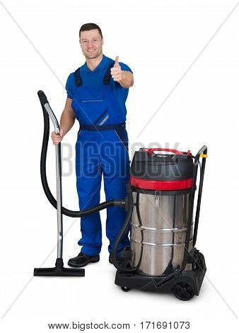 Portrait Of Young Male Janitor With Vacuum Cleaner Showing Thumbs Up On White Background