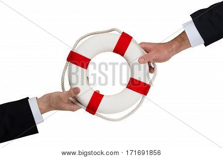 High Angle View Of A Businessmen Hands Holding Lifebelt On White Background
