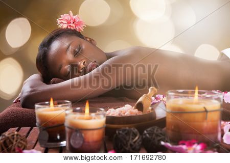 Close-up Of An African Young Woman Relaxing In A Beauty Spa