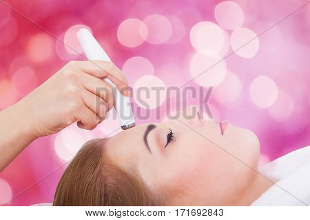 poster of Close-up Of A Young Woman Receiving Microdermabrasion Therapy On Forehead