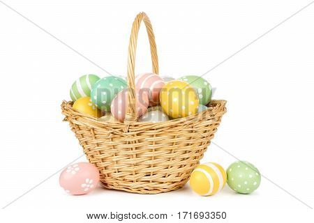 Easter Basket Filled With Hand Painted Pastel Easter Eggs Over A White Background