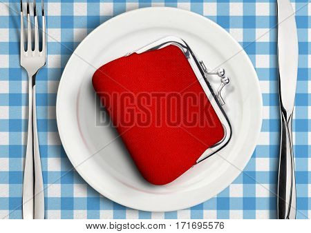 Table setting with wallet on plate finance concept