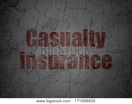 Insurance concept: Red Casualty Insurance on grunge textured concrete wall background