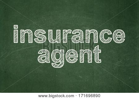 Insurance concept: text Insurance Agent on Green chalkboard background