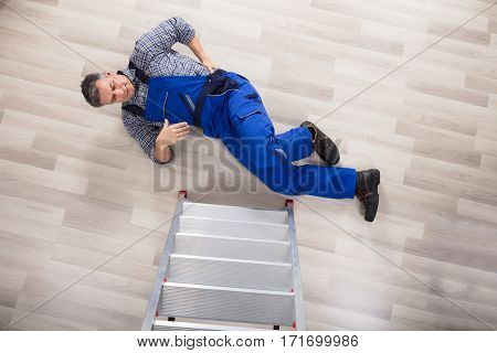 High Angle View Of A Repairman Broke His Back After Fallen From Ladder