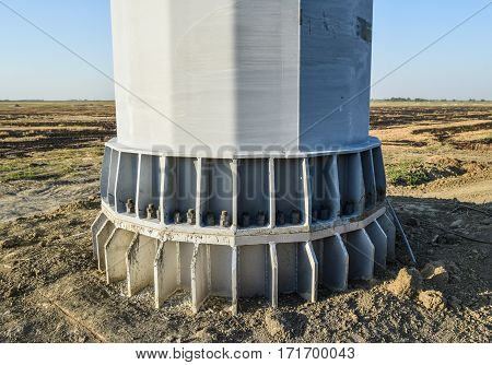 The Base Of The Column Power Line Support. Massive Metal Pole