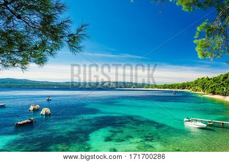 Beautiful sea view with beach Zlatni Rat or Golden Cape on island Brac in Croatia with yacht and boats