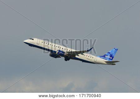 BOSTON - MAY. 6, 2015: Jetblue Airways Embraer 190 take off from Boston Logan International Airport, Boston, Massachusetts, USA.