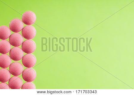 pile of medical pills on light glass background