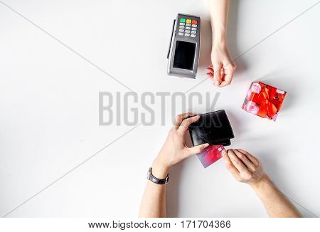 Present purchase in shop with payment by credit card on white table background top view mockup
