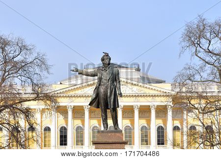 Statue of Alexander Pushkin and Mikhailovsky Palace on Arts Square in St.Petersburg Russia.