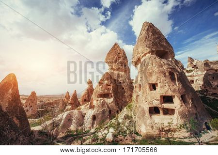 Review unique geological formations in Cappadocia, Turkey. Kappadokiets region, with its valleys, gorges, hills, located between the volcanic mountains in Goreme National Park.