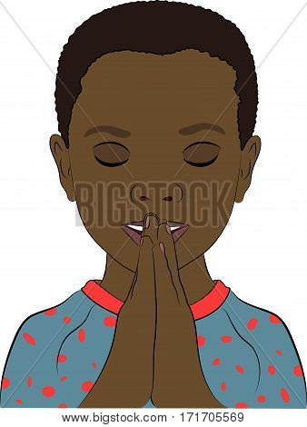 A young african boy wearing pajamas with his hands together in prayer.