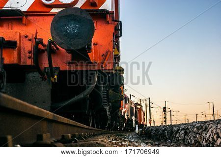 Detail of an red electric locomotive of a freight train Portuguese