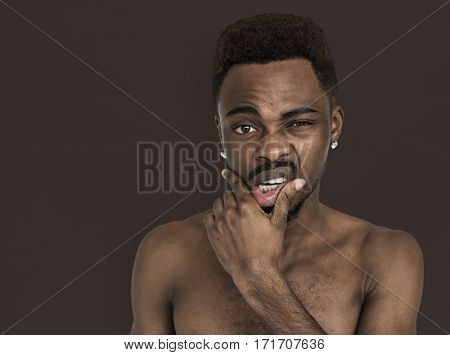 African Man Bare Chest Touching Mouth Portrait