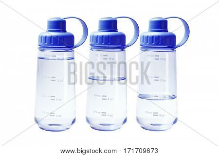 Different Water Levels in Blue Plastic Water Containers