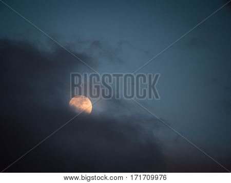 Nightly Sky With Moon Behind Cloud. Outdoors At Night