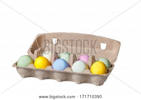 Colorful Easter eggs in a cardboard tray on wooden background, holiday concept
