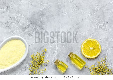 Body care cosmetic set for homemade spa with sea salt and aroma oil on gray background top view mock up