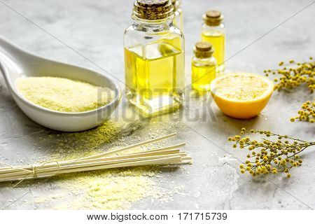 Bodycare cosmetic set with natural aroma oils and sea salt for bathtaking on gray background