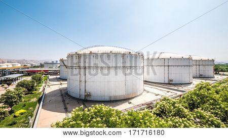oil tank in modern oil refinery in blue sky
