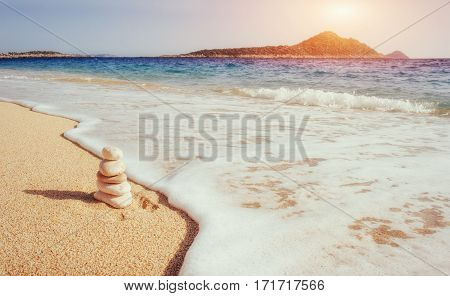 Scenic view of sandy beach and surf waves on the shore