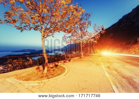 Beautiful scenery lamps and rocks along the coastal highway along the beautiful coastline at sunset.