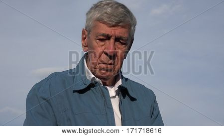Sad Crying Tearful Elderly Old Man with Sky in Background